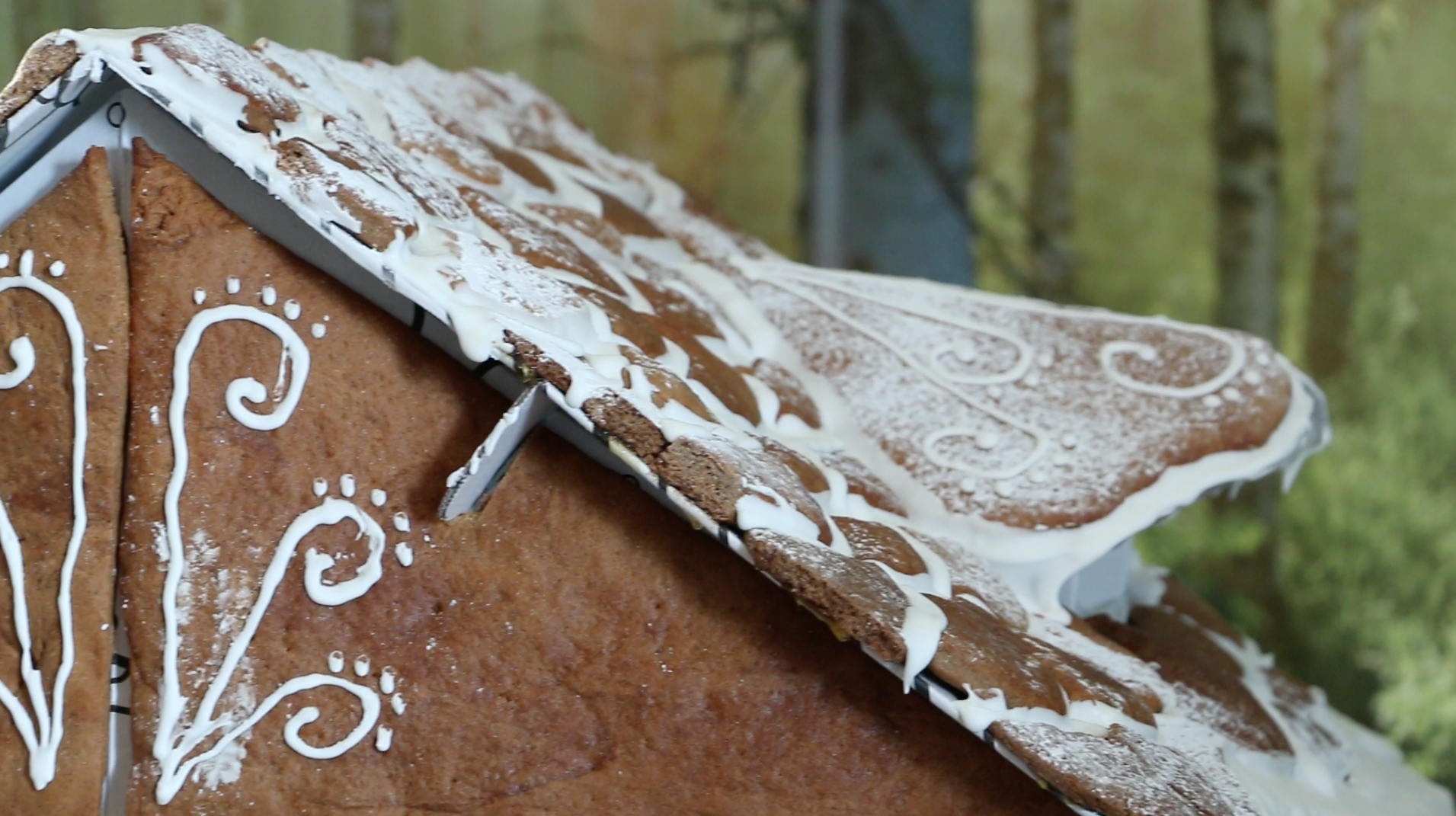 dusting icing sugar on gingerbread house