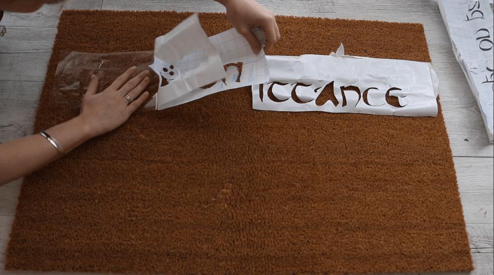 adhesive to mat --DIY literary doormat project