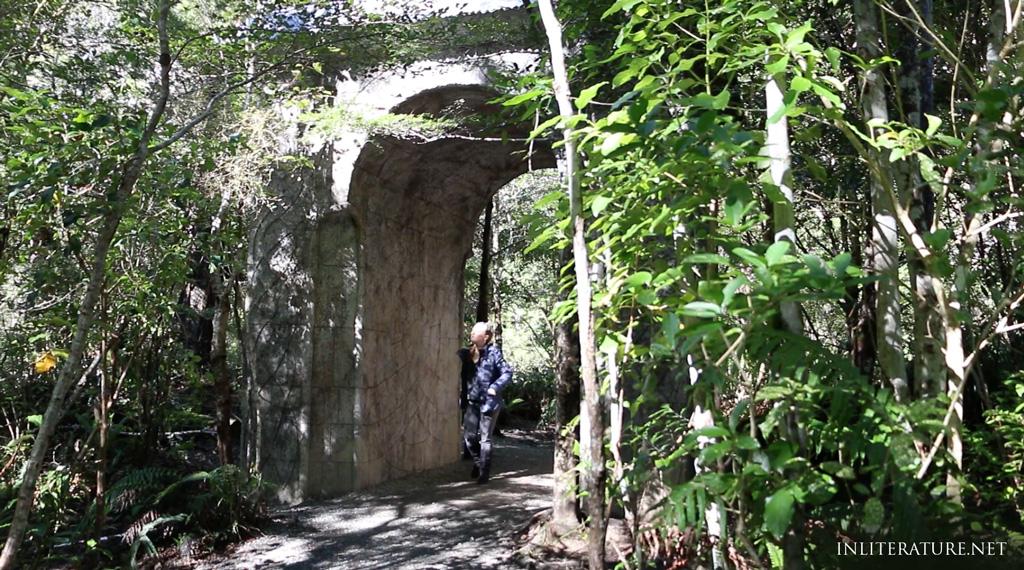 Walking through the Elven inspired arch in Rivendell, Kaitoke Regional Park, New Zealand